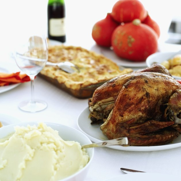 Close-up of mashed potatoes served with roast chicken on a table