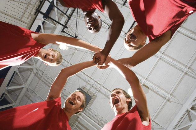 Basketball team in huddle yelling