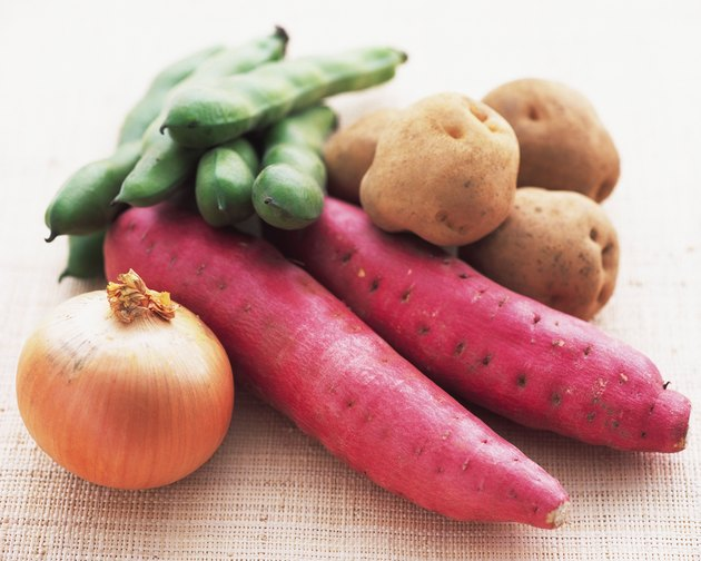 Closed Up Image of Some Red Japanese Potatoes, an Onion, Potatoes and Broad Beans, High Angle View, Differential Focus