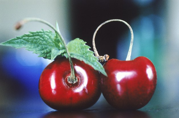 Red cherries with leaf, close-up