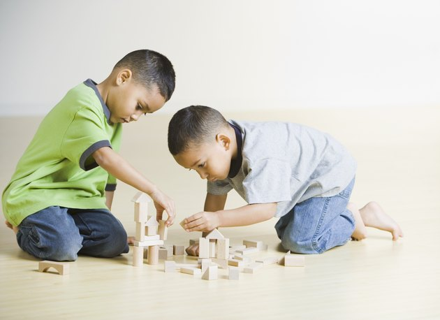 African brothers playing with wooden blocks