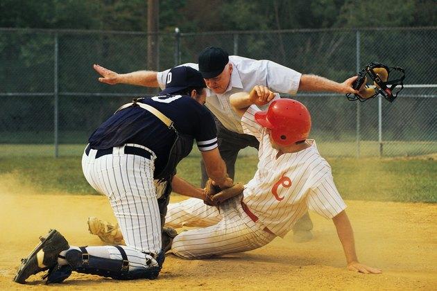 Man sliding into home plate