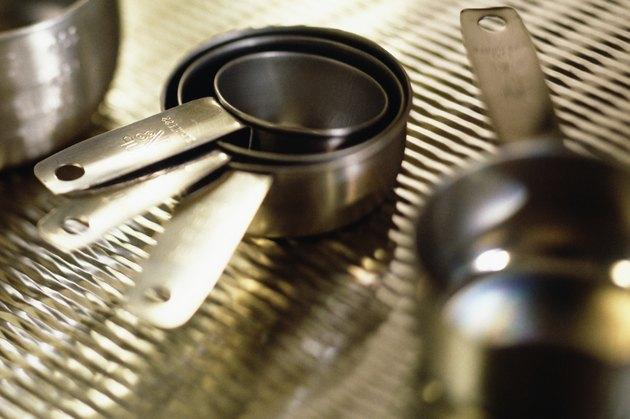 Measuring cups on metal grate