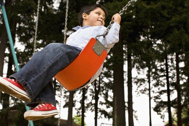 kids on swing in park