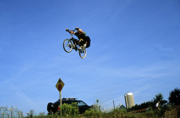 Low angle view of a man performing stunts on a bicycle