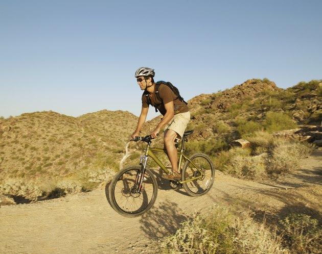 Hispanic man riding bicycle