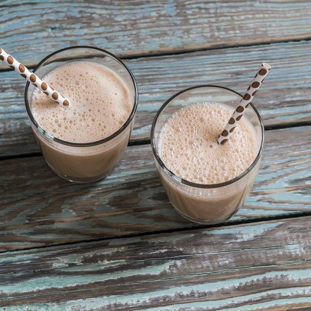 Dulce di leche and ice cream milkshake in glasses