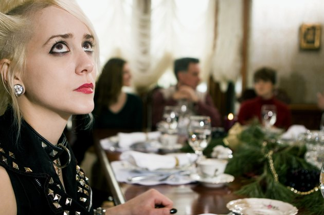 Young woman looking up at dining table
