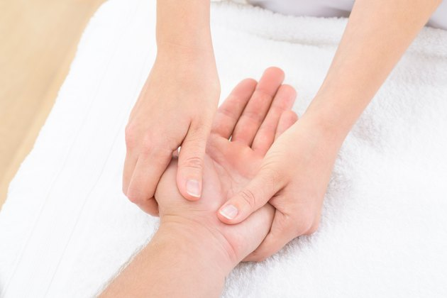 Physiotherapist Massaging Palm
