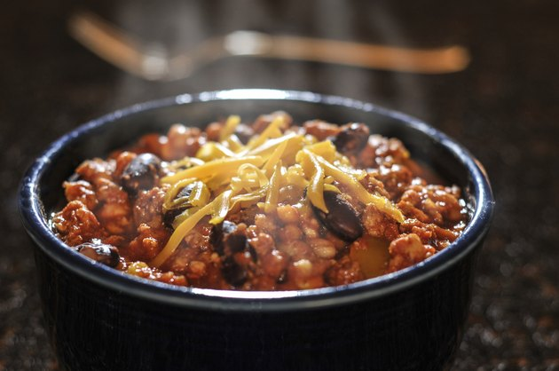 Chili con carne with cheese in a bowl