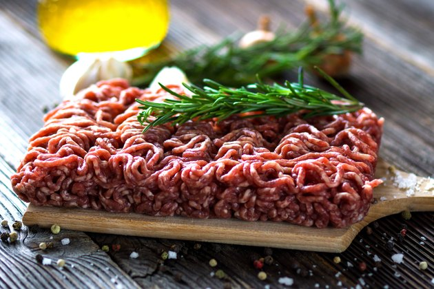 Minced Meat on  wooden background