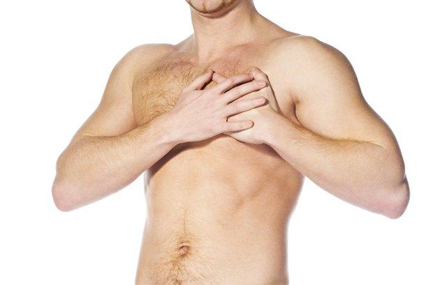 naked man  having a heart attack