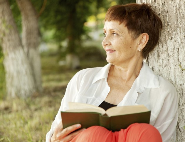 beautiful woman of 50 years with a book