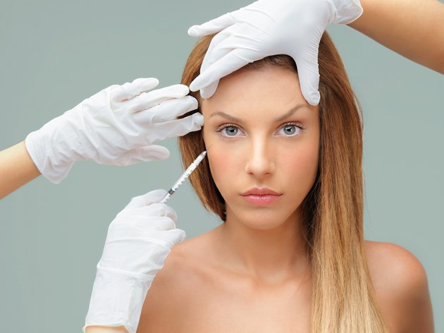 young woman with doctor hands injecting botox