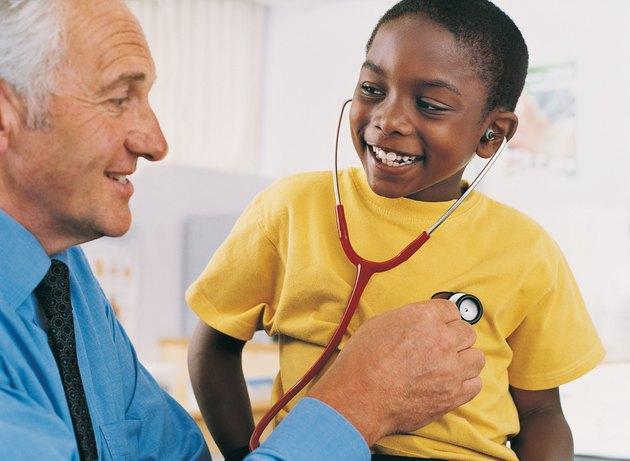 Doctor Explaining Stethoscopes to Boy