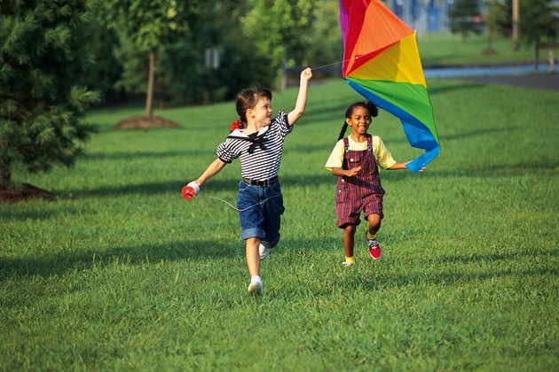 Kids running with rainbow kite