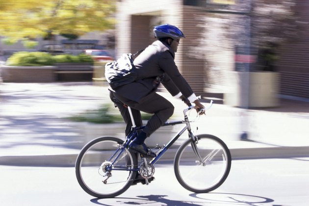 Side profile of a businessman riding a bicycle