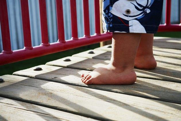 """""""Childs, feet, in, playground"""""""