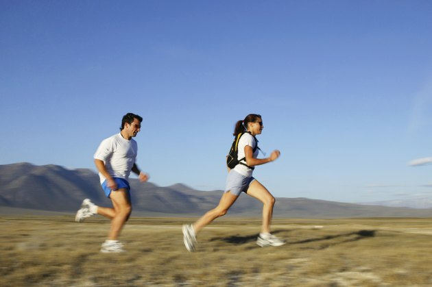 Man and woman running,  California,  USA