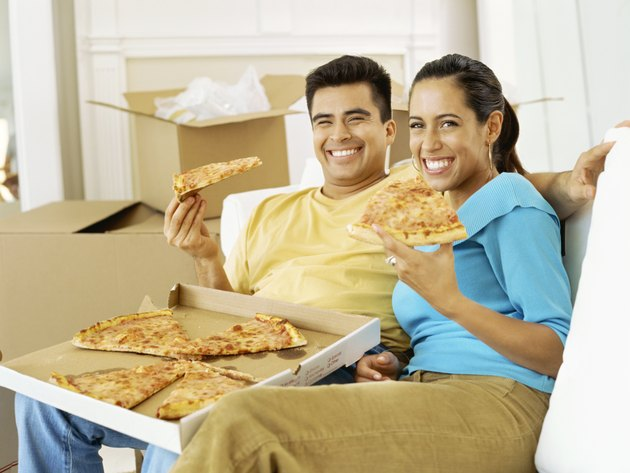 portrait of a young couple eating pizza
