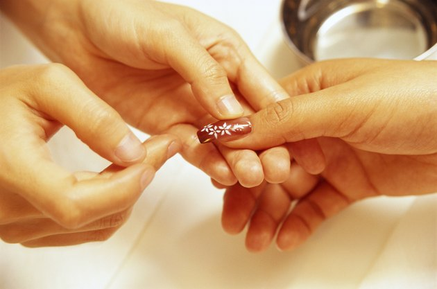 Woman having manicure