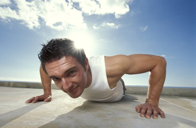 Man doing push-up outdoors