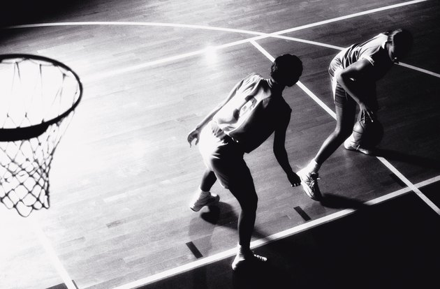 High angle view of two young women playing basketball