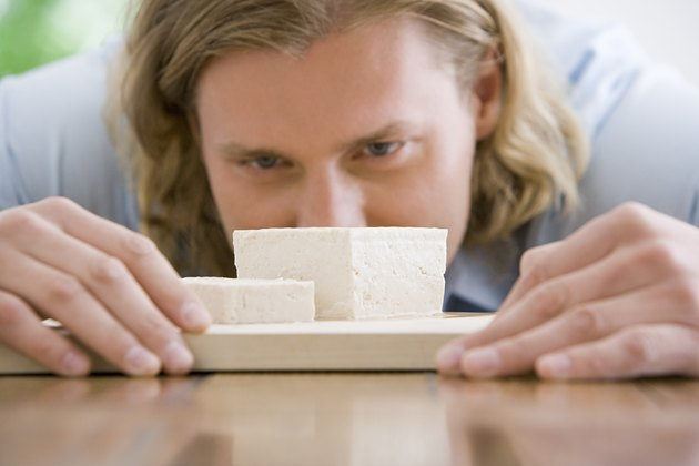 A man looking at tofu