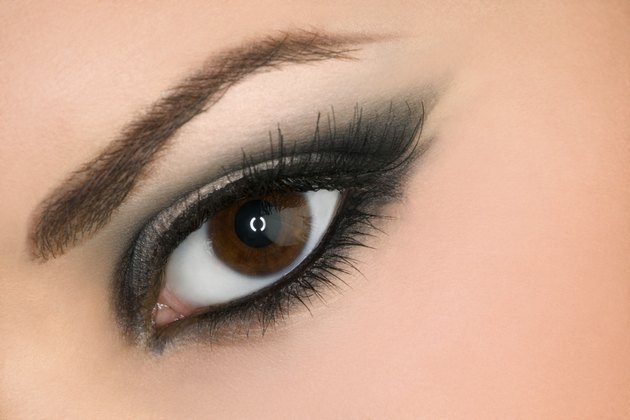 Close-up of a woman's open eye with make-up and mascara looking at the viewer.