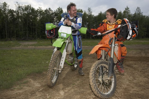 Father and son on off-road motorbikes