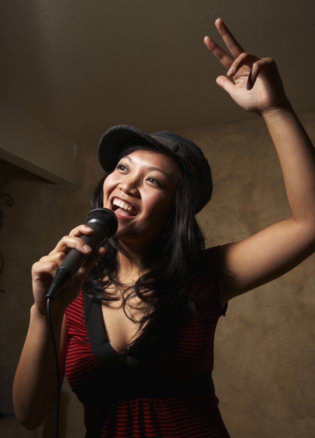 Asian woman singing with microphone