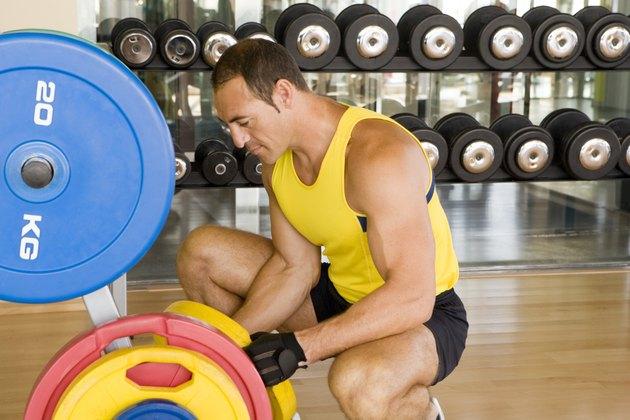 Man adjusting weights