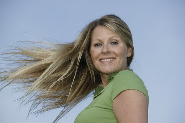 Portrait of woman with windblown hair