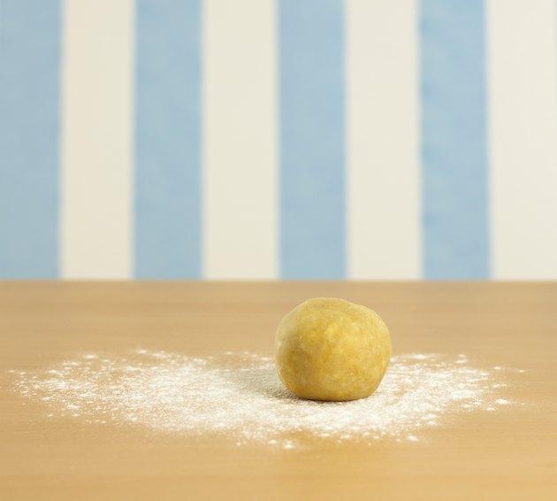 Ball of dough on flour