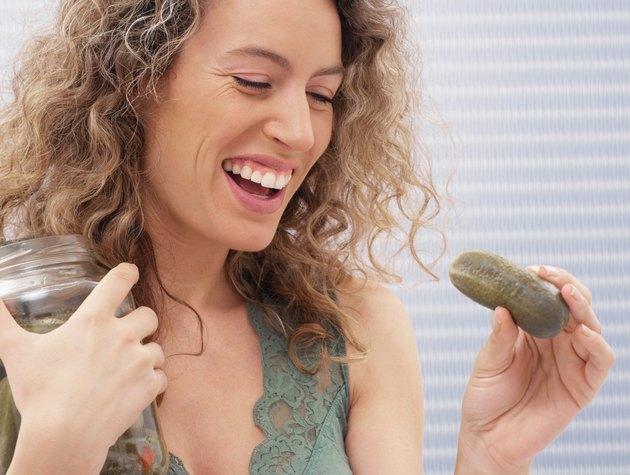 Woman holding a gherkin