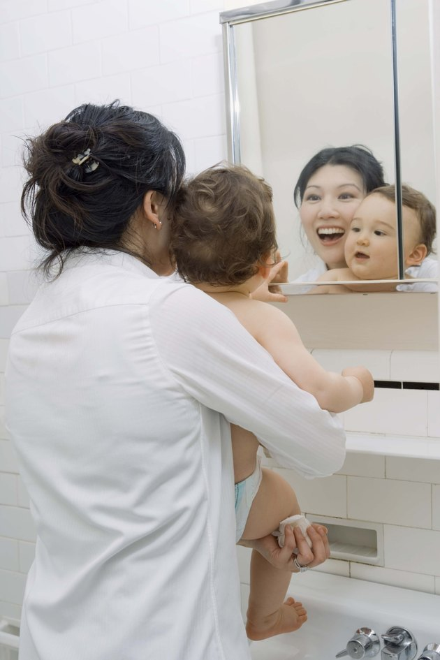 Mother and son looking in mirror