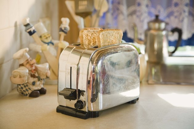 Toast in toaster on table