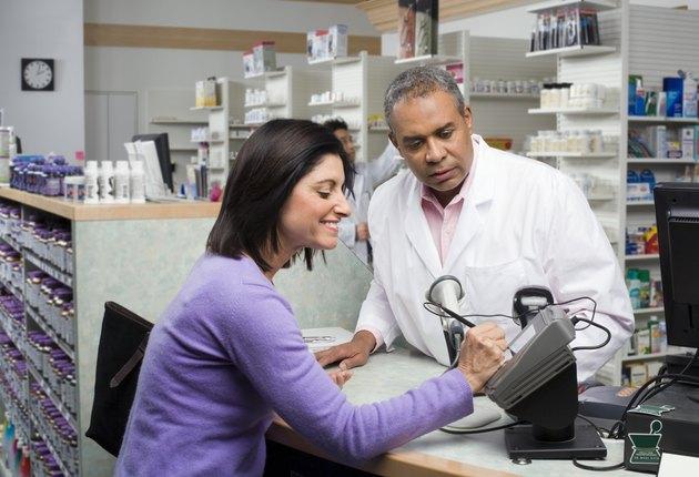 Customer paying pharmacist