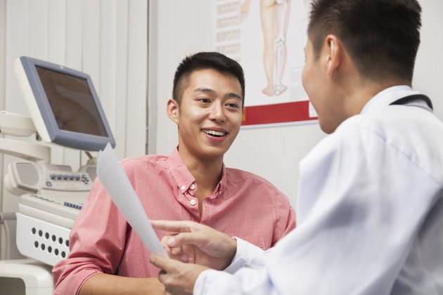 Young Man Talking With Doctor