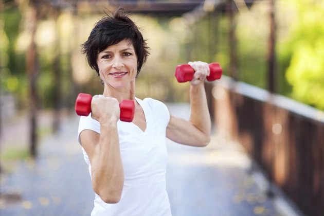 middle aged woman workout with dumbbells