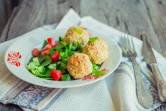 baked chickpeas balls with sesame and vegetable salad, rustic