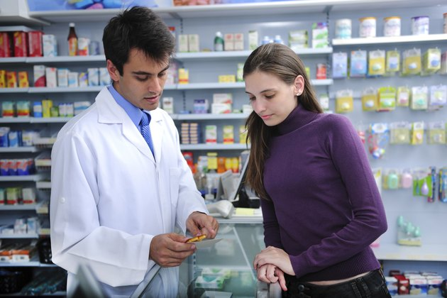 Pharmacist and customer at pharmacy