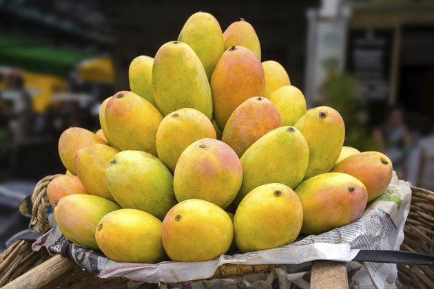 Basket full of ripe mangoes