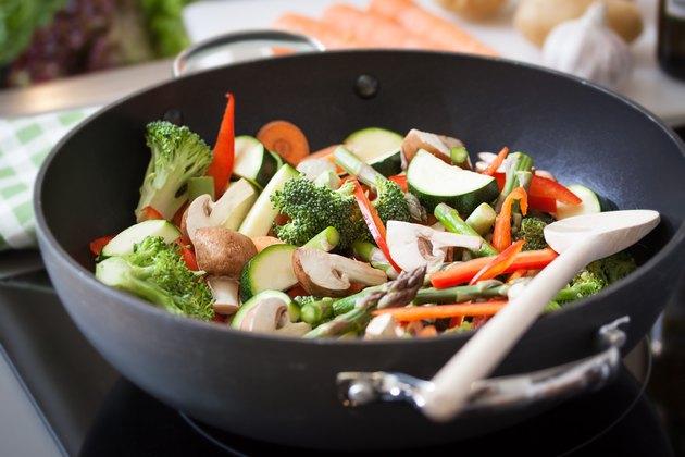 Wok stir fry vegetables with zucchini, spring asparagus, paprika