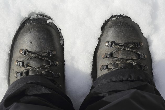 Hiking boots on snow, top view