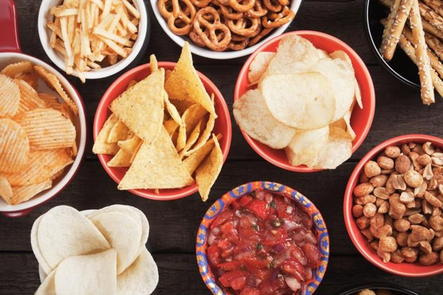Tortilla chips and other salty snacks with homemade salsa