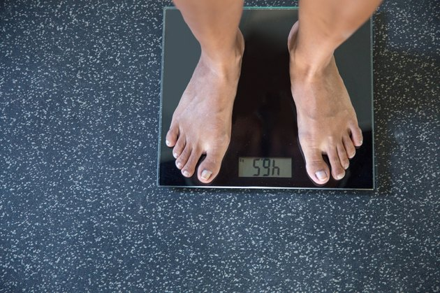 Standing on weight scale