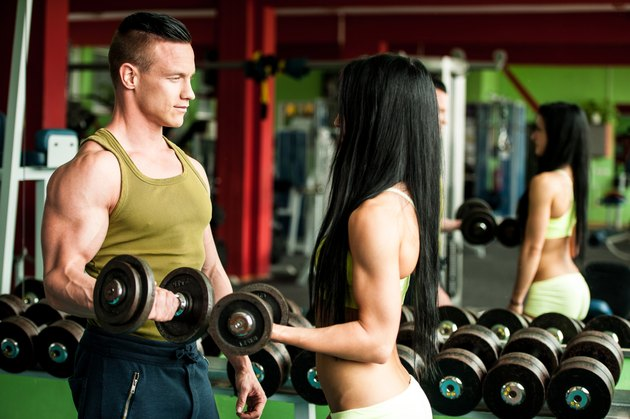 Fitness couple workout fit man and woman train in gym