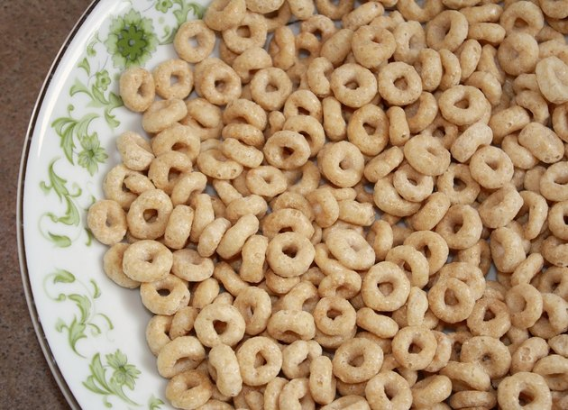 Dry wholegrain cheerios in a cereal bowl