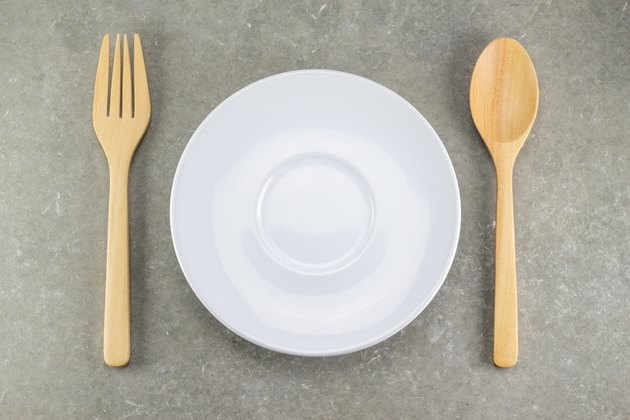 wood spoon and fork with white dish